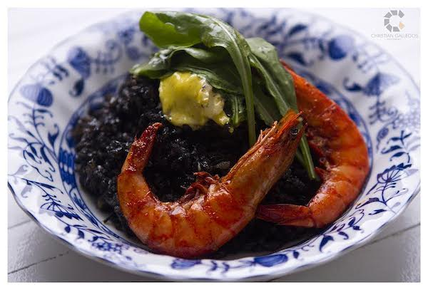 Paella Negra with Prawns and Arugula