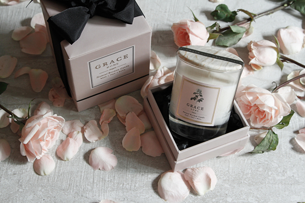The Grace Home Candle comes in a lovely glass jar with a marble cover, an added touch of elegance and something not commonly seen in candle packaging. Marble stone is known to be unique, as such as no two pieces are exactly look alike. In a way, each Grace Home Candle is custom-made. This lid can be used as a cover to preserve the scented oils of the candle and make it last longer. Or it can be the jar's coaster to protect the surface the candle is placed on.
