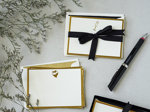 The note cards are of premium paper with gold foil border and gold stamped decorative icons. The icons are quite playful—my little reminder to enjoy life's simple pleasures. These icons are a strawberry, my favorite food, and a champagne flute, a reminder of festive, celebratory occasions.