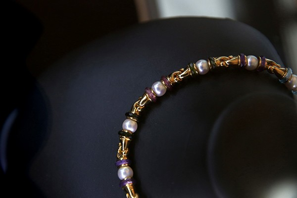 Bulgari. A cultured pearl and gem-set 'Gancio' necklace