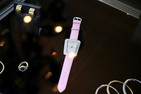 Jewelled ladies' timepieces by Cartier, Piaget, and Rolex