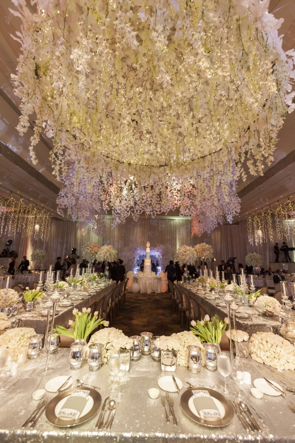 Real Weddings - Pure white blossoms hang from the ceiling of the grand Rizal Ballroom in a wedding last December 2015