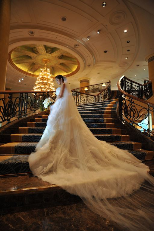Real Weddings - The blushing bride stands elegantly on the grand staircase of Makati Shangri-La
